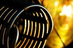Primer de la hornilla del globo del aire caliente en la hora de oro foto de archivo