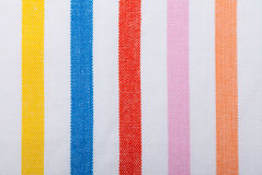 Primer de la materia textil rayada colorida como fondo o textura Fotografía de archivo libre de regalías
