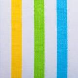 Primer de la materia textil rayada colorida como fondo o textura Imagen de archivo libre de regalías