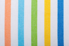 Primer de la materia textil rayada colorida como fondo o textura Fotos de archivo