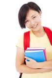 Primer de la muchacha asiática joven del estudiante con el libro Fotografía de archivo libre de regalías