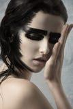 Primer de la muchacha con maquillaje extraño fotografía de archivo libre de regalías