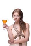 Primer de la muchacha hermosa con el vidrio de alcohol Fotos de archivo libres de regalías