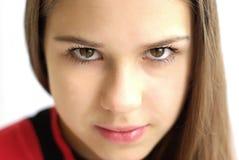 Primer de la muchacha hermosa en el fondo blanco imagen de archivo libre de regalías