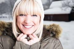 Primer de la nieve de goce femenina alegre afuera Fotos de archivo libres de regalías