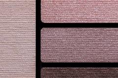 Primer de la paleta de colores de los accesorios del maquillaje Foto de archivo libre de regalías