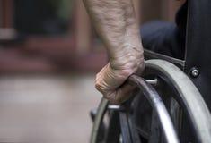 Primer de la silla de ruedas Foto de archivo libre de regalías