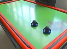 Primer de la tabla del hockey del aire con la paleta Foto de archivo libre de regalías