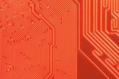 Primer de la tarjeta de circuitos de ordenador en naranja Fotografía de archivo