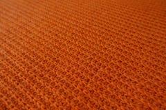 Primer de la tela anaranjada brillante del punto acanalado Fotos de archivo