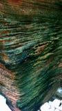Primer de la textura del corte de la roca de una isla fotografía de archivo