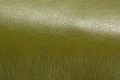 Primer de la textura del fondo de Olive Green Glossy Artificial Leather Foto de archivo libre de regalías