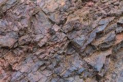 Primer de la textura del mineral de hierro - minerales naturales en la mina Textura de piedra del cielo abierto Extracción de los Fotos de archivo