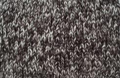 Primer de la textura hecha punto de las lanas Imagen de archivo