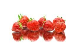 Primer de las fresas en el fondo blanco Fotos de archivo libres de regalías