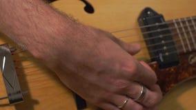 Primer de las manos de los guitarristas metrajes