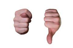 Primer de las manos masculinas con los higos y el pulgar abajo Fotografía de archivo libre de regalías