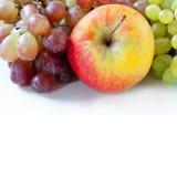 Primer de las manzanas y de las uvas Imagen de archivo libre de regalías