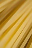 Primer de las pastas crudas de los espaguetis Fotos de archivo libres de regalías