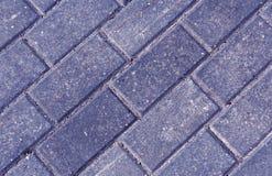 Primer de las piedras del adoquín del pavimento del color Imagen de archivo