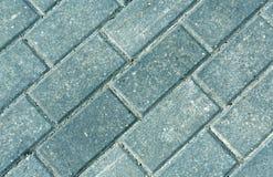Primer de las piedras grises del adoquín del pavimento Imagen de archivo