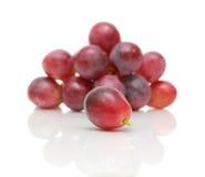 Primer de las uvas en el fondo blanco Imagen de archivo libre de regalías