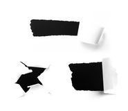Primer de los agujeros de una obscuridad en el Libro Blanco fotografía de archivo libre de regalías