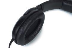 Primer de los auriculares de la parte en el fondo blanco. Imagen de archivo