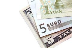 Primer de los billetes de banco (dólar, euro, yuan). Foto de archivo libre de regalías