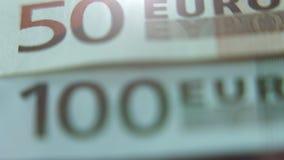 Primer de los billetes euro de 50 y 100 notas Visión macra almacen de video