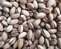 Primer de los pistacchios de la cáscara de nuez fotografía de archivo libre de regalías