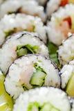 Primer de rebanadas deliciosas de sushi Imagen de archivo libre de regalías