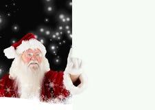 Primer de señalar de Papá Noel Imagen de archivo