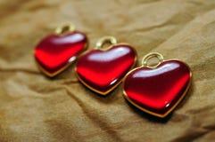 Primer de tres corazones Imagenes de archivo