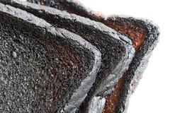 Primer de tres panes de pan quemado Fotos de archivo libres de regalías