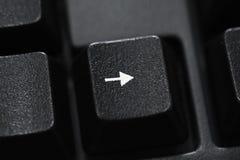 Primer de un botón negro de la flecha del teclado Fotos de archivo libres de regalías