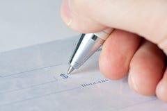 Primer de un cheque Foto de archivo libre de regalías