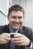 Primer de un hombre de negocios With Coffee Cup Imágenes de archivo libres de regalías