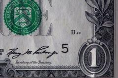 Primer de una cuenta usada de los billetes de 1 dólar Foto de archivo