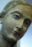 Primer de una estatua de piedra de la cara de una mujer Imagen de archivo libre de regalías