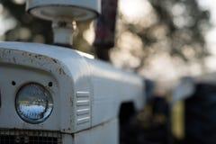 Primer de una linterna vieja del tractor Fotografía de archivo libre de regalías