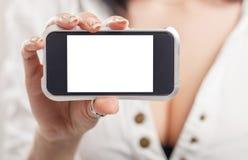 Primer de una mano de la muchacha que muestra un sc en blanco horizontal del smartphone Fotografía de archivo