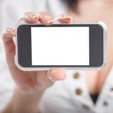 Primer de una mano de la muchacha que muestra un sc en blanco horizontal del smartphone Imagenes de archivo