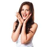 Primer de una mujer joven feliz sorprendida Imagen de archivo libre de regalías