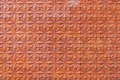 Primer de una pared de ladrillo con los ladrillos rojos Imagen de archivo libre de regalías