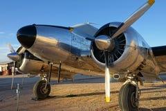 Primer del aeroplano del vintage en luz de la puesta del sol Fotografía de archivo libre de regalías