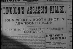 Primer del asesino Killed de Lincoln del título de periódico almacen de video