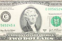 Primer del billete de dólar del americano dos Fotografía de archivo