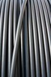 Primer del cable negro de la electricidad Foto de archivo libre de regalías