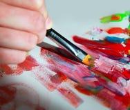 Primer del cepillo y de la paleta Imagen de archivo libre de regalías